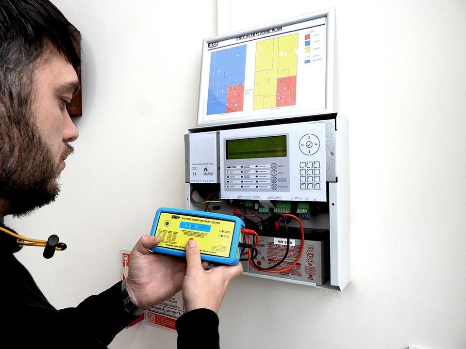 Engineer Testing Fire Alarm Panel